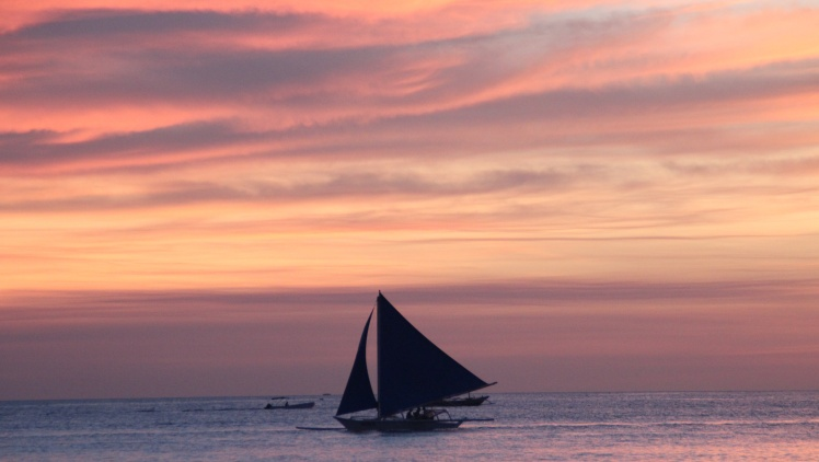 A sail and sunset.